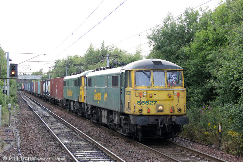 There's still plenty of life in the old workhorses! 86627 and 86638 are seen at Holytown with 4M11, 1823 Coatbridge to Crewe Basford Hall on 6th August 2012.