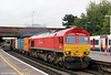 DB Schenker liveried 66097 adds some colour to an overcast scene at Southampton Central heading 6B43, 0938 Eastleigh Yard to Southampton Western Docks on 12th June 2012.