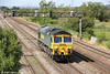 66516 passes Coedkernew running as 0O52, 1030 Wentloog to Stoke Gifford on 28th July 2012.
