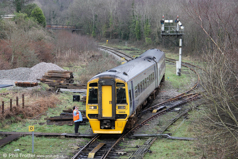 The driver of unrefurbished 158826 hands over the token to the signalman at Tondu on 14th January 2012. 158826 was forming the 1217 Maesteg to Cheltenham Spa.
