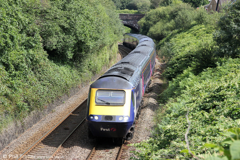 1B28, the 1137 London Paddington to Carmarthen is seen at Cockett on 12th August 2012.