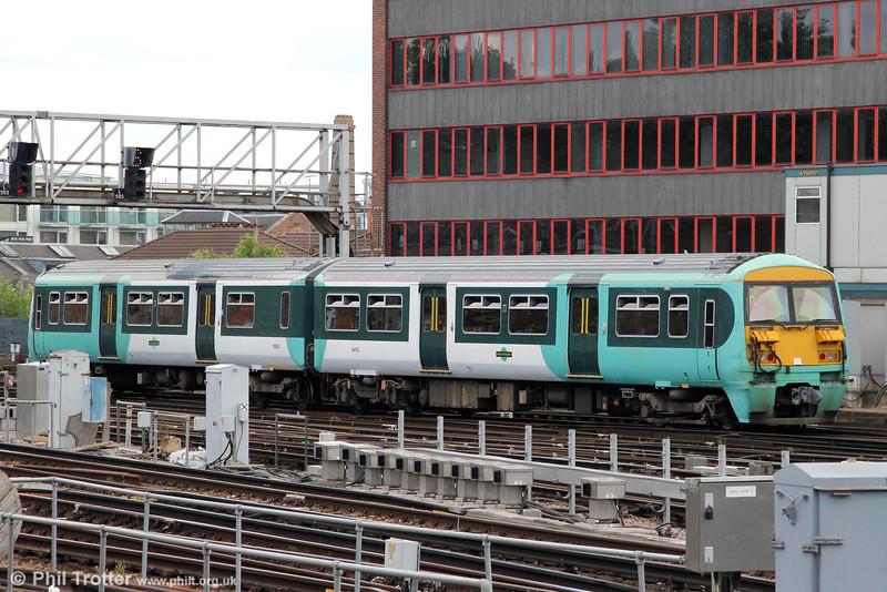 456016 departs from London Bridge with 2G28, 2P77 1409 to Tattenham Corner on 26th August 2012.