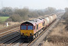 66037 passes Coedkernew with 6B98, 0938 Newport ADJ to Cardiff Canton Depot 4-wheel fuel oil tanks on 23rd March 2012.