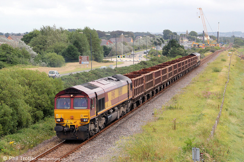 With ongoing work to replace Loughor Viaduct in the background, 66158 passes Loughor with 6Z42, 1200 Margam to Trostre empty SSA scrap wagons on 12th August 2012. Classmate 66230 was at the rear.