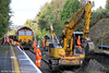 A line occupation on 13th and 14th October 2012 enabled contractors to make significant progress with the Cockett to Llandeilo Junction redoubling project. This was the busy scene at Gowerton on the 13th with drainage work under way. 66145 was waiting to proceed with spoil train 6W01 to Newport ADJ and subsequently to Crewe Basford Hall.