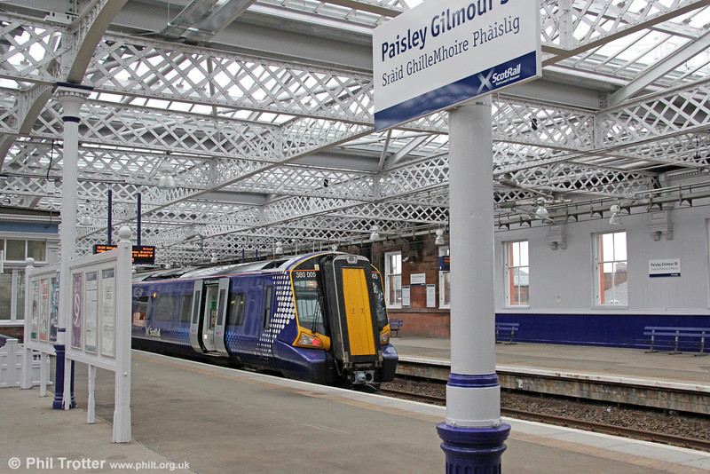 An estimated £9m has been spent on improvements to the historic B-listed Paisley Gilmour Street Station, including a new overall roof and repaint. 380005 pauses  in the airy atmosphere, forming 1W47, 1550 Glasgow Central to Weymiss Bay on 5th August 2012.