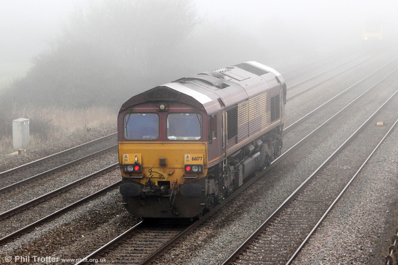 White roofed 66177 passes Coedkernew in the fog, running as 0B24, Wentloog to Newport ADJ on 1st March 2012.
