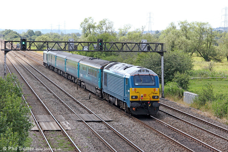 67001 brings up the rear of 1V41, 0805 Holyhead to Cardiff Central 'Olympic Extra' at Coedkernew on 28th July 2012.