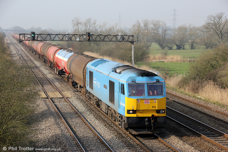 A warm spring morning finds 60074 'Teenage Spirit' passing Coedkernew with 6B13, 0505 Robeston to Westerleigh on 23rd March 2012.