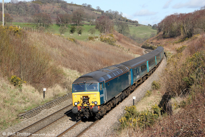 Providing extra capacity for the rugby at Cardiff, 57313 passes Llanfihangel with 1V41, 0807 Holyhead to Cardiff Central on 10th March 2012. Classmate 57315 was at the rear.