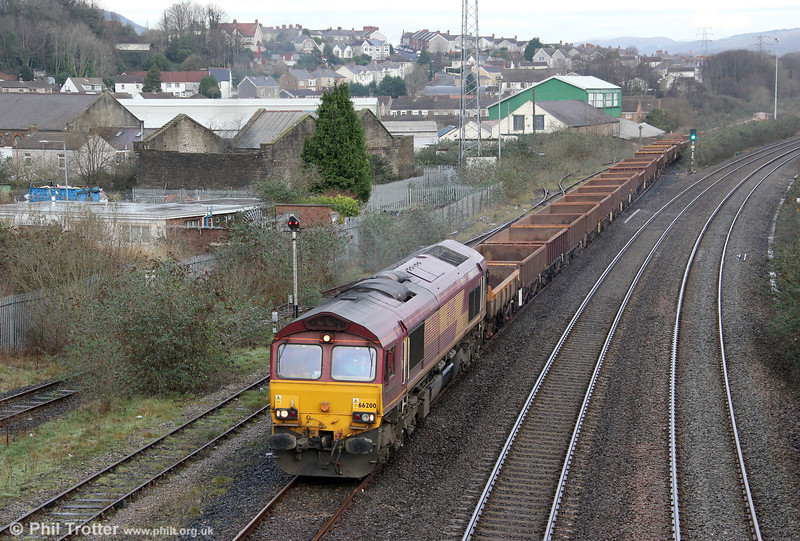 Having run around its train, 66200 'Railway Heritage Committee' departs from Briton Ferry Yard with 6W43, 0649 Westbury to Margam on 14th January 2012.