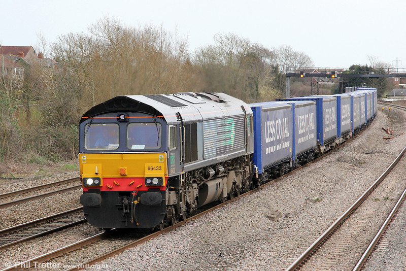 DRS 66433 passes Magor with 4V38, 0822 Daventry to Wentloog, 'Tesco Express' on 21st March 2012.