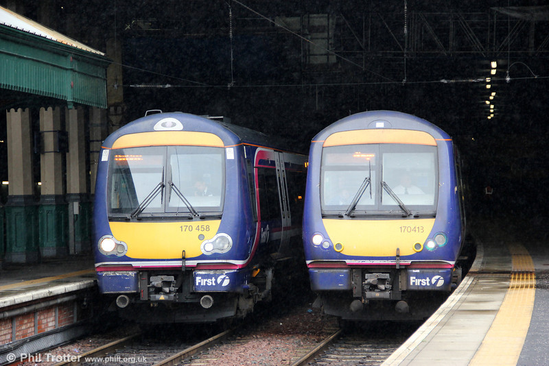 Scotrail has a fleet of 59 'Turbostars' centred around Edinburgh. 170413 and 170458 prepare to leave Edinburgh Waverley as 1R29, 1100 to Glasgow Queen Street and 2P35, 1103 to Dunblane on 6th August 2012.