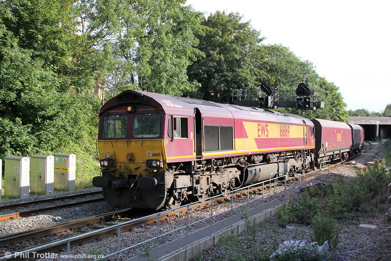 A work stained 66169 passes Gaer Junction with 4C45, 1500 Aberthaw Power Station to Avonmouth on 14th August 2012.