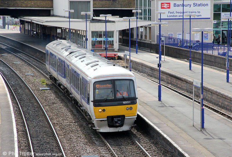 Chiltern's 165011 departs from Banbury forming 1D24, 1033 London Marylebone to Stratford-upon-Avon on 21st April 2012.