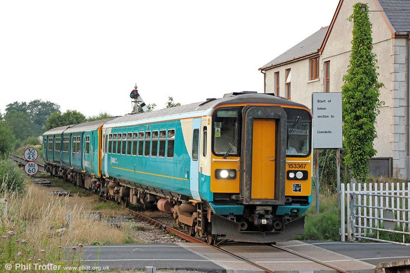 A far cry from the heady days when class 37s or 50s handled the Royal Welsh Show additionals, 153367 and 150213 are seen at Pantyffynnon with 1Z38, 1845 Builth Road to Cardiff Central on 22nd July 2013. Rivet counters will note the black cab window surrounds, making the appearance of these units a little less severe.