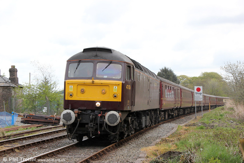 WCRC 47826 approaches Llanwrtyd Wells with Compass Tours 1Z52, 0605 Holyhead to Cardiff Central, 'The Heart of Wales Scenic Rambler' on 18th May 2013.