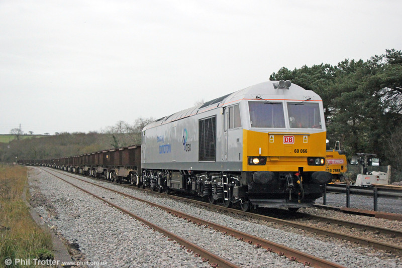 Newly overhauled 60066 in Drax Biomass livery, passes Llangennech with 6B16, 1536 Trostre Works to Margam on 14th December 2013.