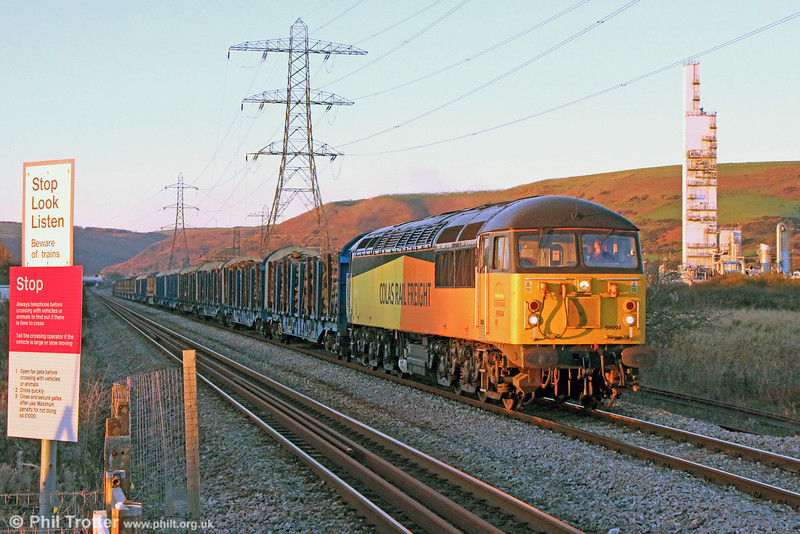 A cloudless afternoon extended the daylight hours just long enough to see Colas Rail 56094 pass Margam with 6Z51, 1522 Baglan Bay to Chirk (Kronospan) on 22nd November 2013.