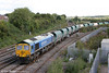 Bardon Aggregates liveried 66623 'Bill Bolsover' at Westbury North Junction with 6O49, 1023 Theale to Wool on 7th September 2013.