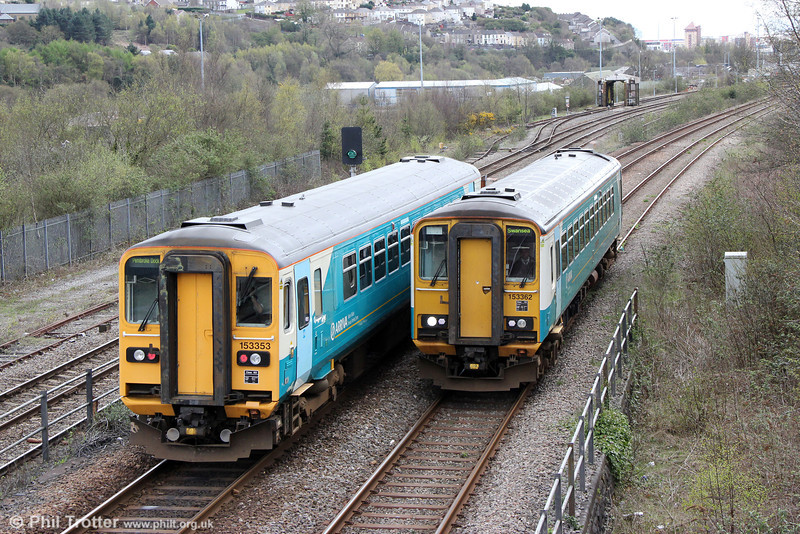 A comparison of the original (right) and rebuilt ends of the class 153 units which were converted from 2-car class 155s in 1991-1992. 153353 and 153362 pass at Swansea Loop East on 27th April 2013. 153353 was forming 2E13, 1109 Pembroke Dock to Swansea while 153362 was forming 2M57, 1316 Swansea to Shrewsbury; both show destinations for services in the opposite directions!