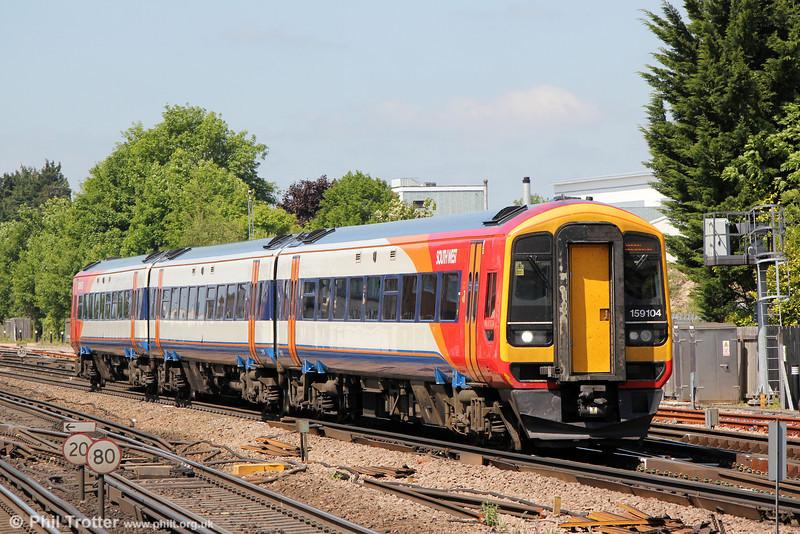 159104 approaches Basingstoke forming 1L34, 10-47 Salisbury to London Waterloo on 8th June 2013.