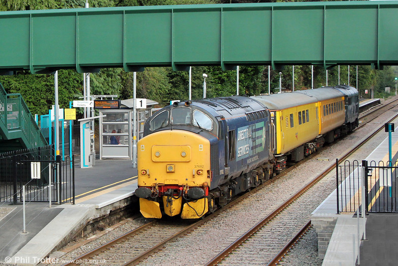 DRS 37682 brings up the rear of 1Q13, 0800 Landore TMD to Newport Alexandra Dock Junction via Llandrindod Wells at Gowerton on 20th August 2013.