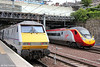 East meets west: 91103 at the rear of 1E19, 1430 Edinburgh to London Kings Cross and VWC 390135 with 1Z54, 1303 Carlisle to Edinburgh at Edinburgh Waverley on 12th July 2013.