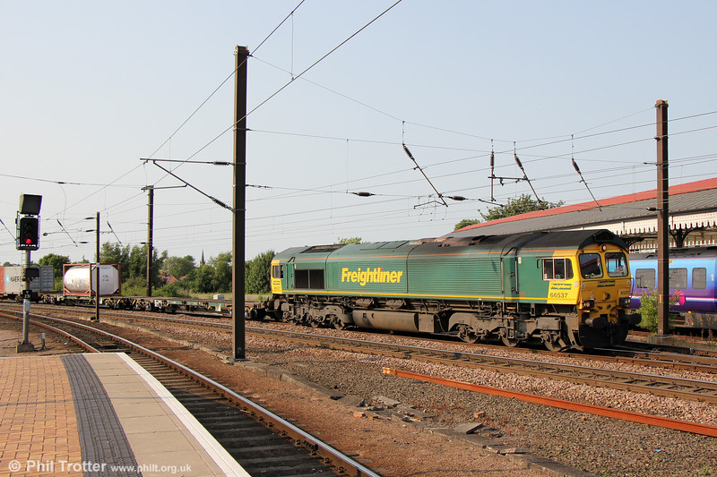 66537 at York heading 4L79, 1540 Wilton to Felixstowe on 5th July 2013.