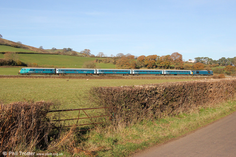 82308 leads 1V54, 0807 Holyhead to Cardiff Central 'Rugex' through Llanfihangel on 30th November 2013. Propulsion was provided by 67001.