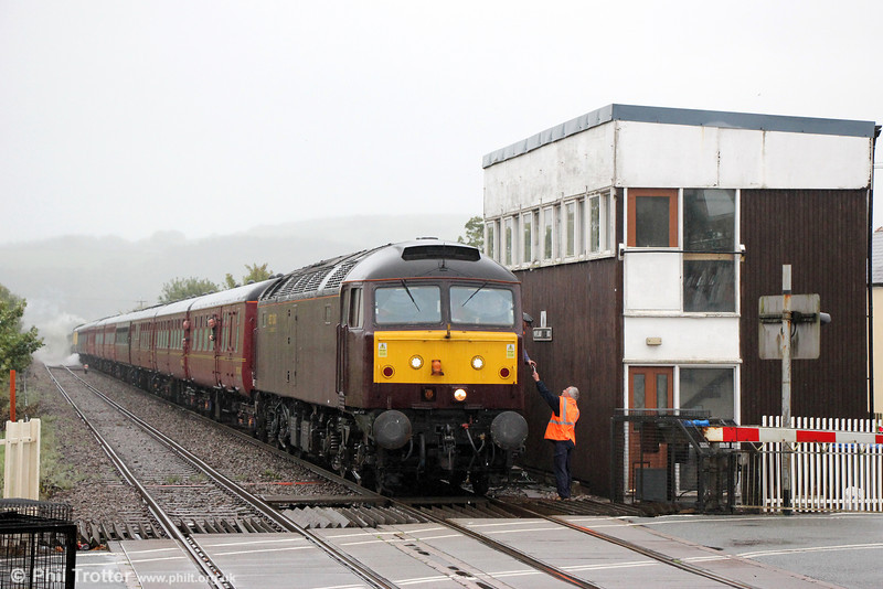 The driver of WCRC 47237 picks up the token for the Pembroke Dock branch at Whitland during the Railway Touring Company's 1Z39, 0821 Bristol Temple Meads to Tenby, 'The Pembroke Coast Express' on 15th September 2013.
