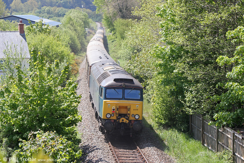 Nowadays with West Coast, 57316 brings up the rear of Statesman Rail's 1Z96, 0526 Hull to Aberystwyth, 'The Welsh Mountain Statesman' at Llandre on 25th May 2013. The loco is not permitted to run on the Cambrian under its own power as it is non-ERTMS fitted.