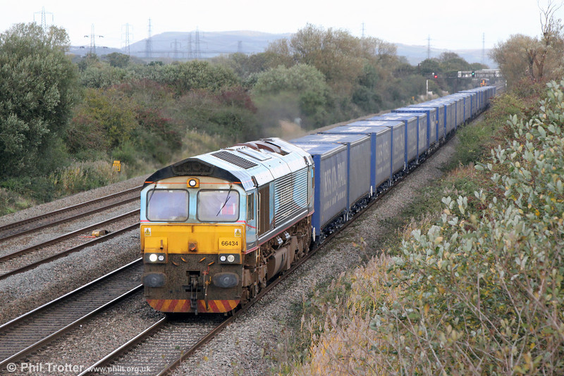 Looking past its best, Malcolm liveried DRS 66434 passes Coedkernew with 4V38, 0909 Daventry to Wentloog 'Tesco Express' on 3rd November 2013.