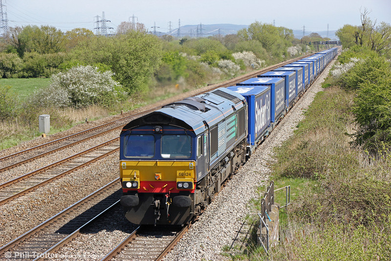 The Tesco trains seem to be getting longer; must be all the Irn-Bru I've been drinking. 66424 passes Coedkernew with 4V38, 0825 Daventry to Wentloog on 6th May 2013.