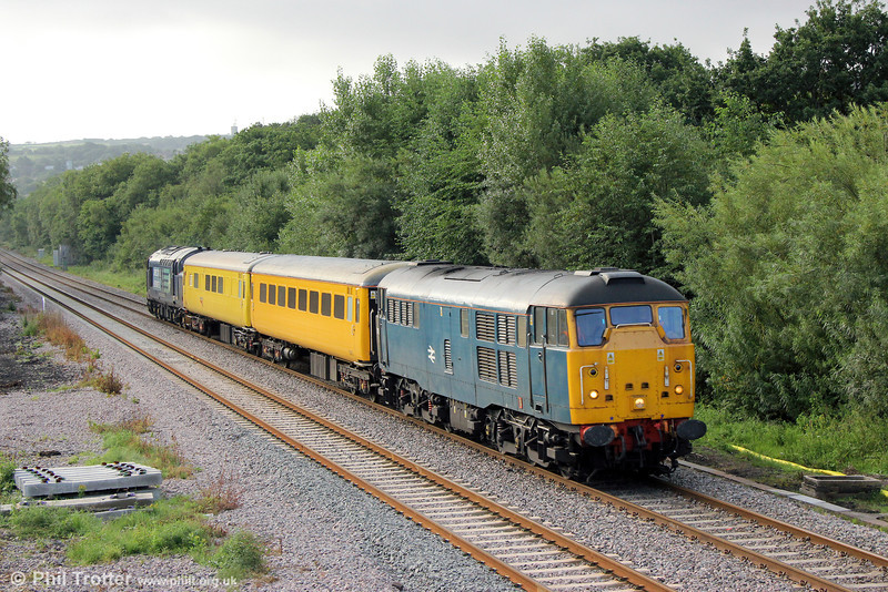 BR blue 31106 passes Gowerton with 1Q13, 0800 Landore TMD to Newport Alexandra Dock Junction via Llandrindod Wells on 20th August 2013. DRS 37682 was at the rear of the formation.