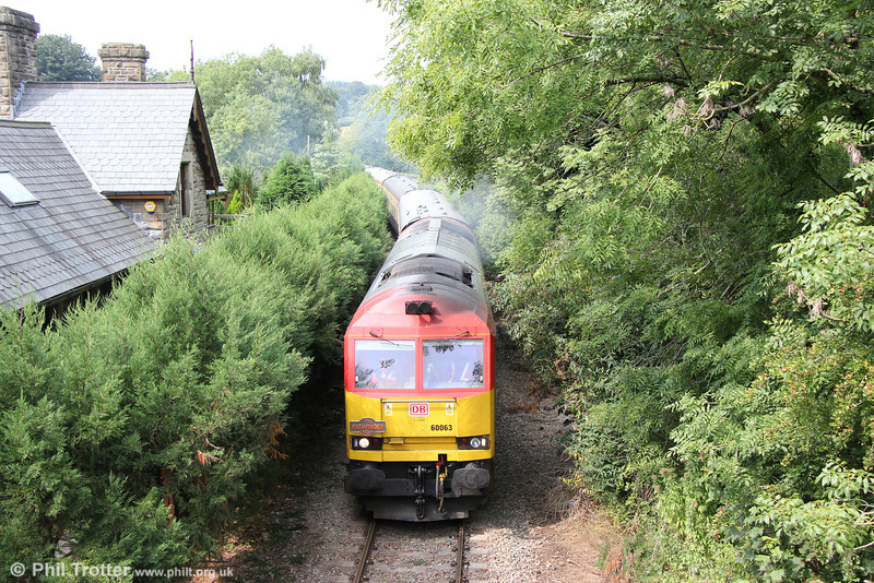 60063 passes the former Church Road Station, Machen with Pathfinder's 1Z59, 1304 Machen Quarry to Cwmbargoed via Penarth, 'The Taffy Tug' on 25th August 2013.