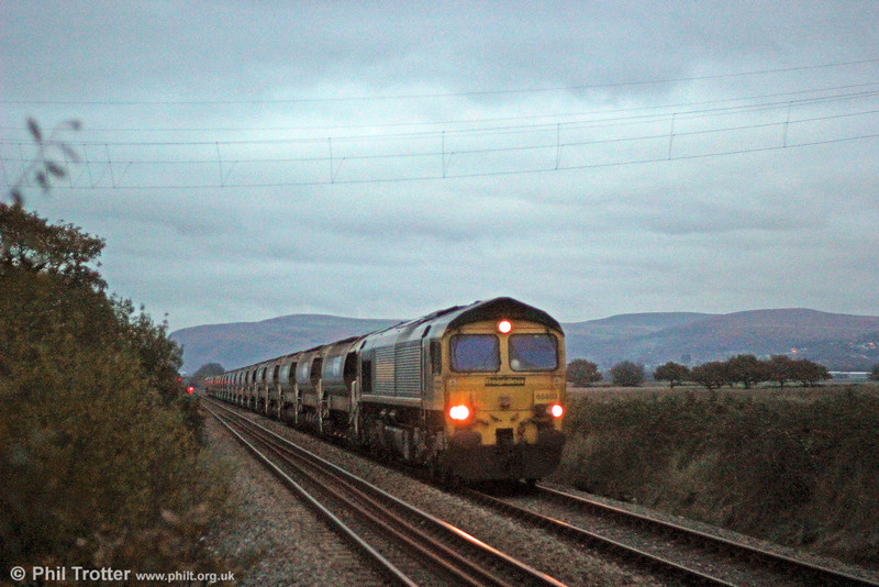 Freightliner locos are relatively uncommon west of Swansea. On 17th November 2013, 66603 passes Langennech at dusk with 6W49,  1224 Westbury to Haverfordwest. DBS 66136 was at the rear. Roll on spring...