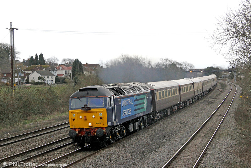 DRS 47828 heads Northern Belle 1Z38, 1313 London Paddington to Cardiff Central 'Rugex' through Magor on 16th March 2013.
