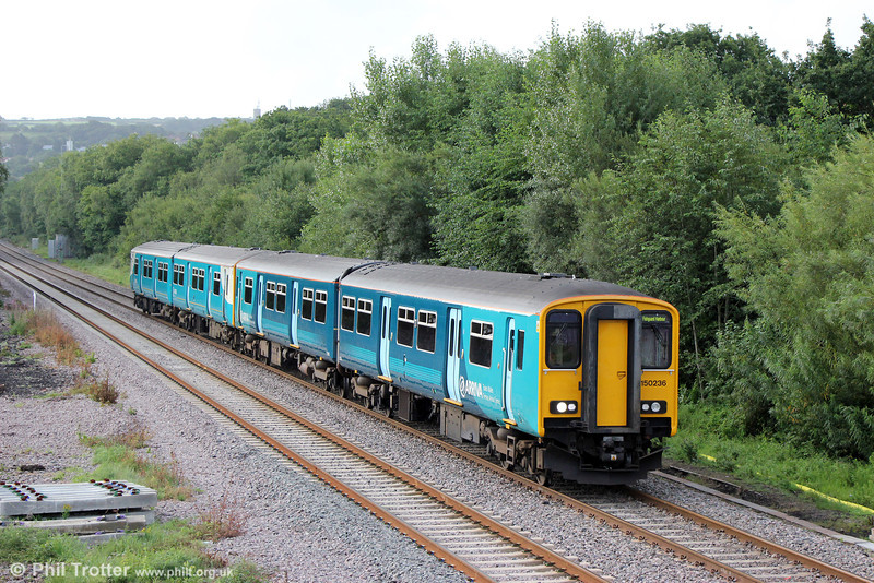 Reliveried 150236 slows to call at Gowerton while leading 1B53, 0642 Cardiff Central to Pembroke Dock on 20th August 2013. The two units will split at Whitland, with one forming 2E18, 0907 Whitland to Fishguard Harbour.