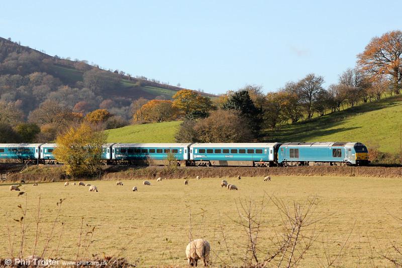 67001 propels 1V54, 0807 Holyhead to Cardiff Central 'Rugex' through Llanfihangel on 30th November 2013.