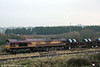 66181 approaches Trostre Works with 6B26, 0640 from Margam on 8th March 2013.