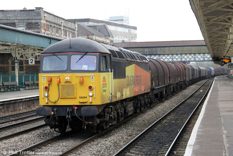 Just like old times: a class 56 on a steel train at Newport. DBS has been hiring Colas 56094 to move steel coil from Llanwern to Newport Docks for export, reportedly to Bilbao. On 18th March 2013, the loco is seen passing through Newport with 6F03, 0933 from Llanwern exchange sidings.