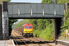 60054 is framed in the road bridge at Bynea with 6B61, 1035 Trostre to Margam on 21st July 2013.