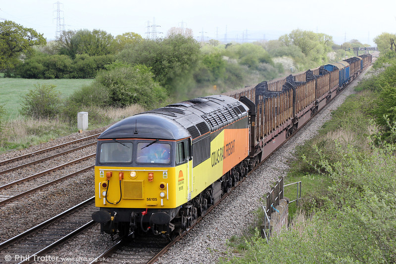 56105 passes Coedkernew with 6Z50, 0713 Chirk (Kronospan) to Baglan Bay on 10th May 2013.