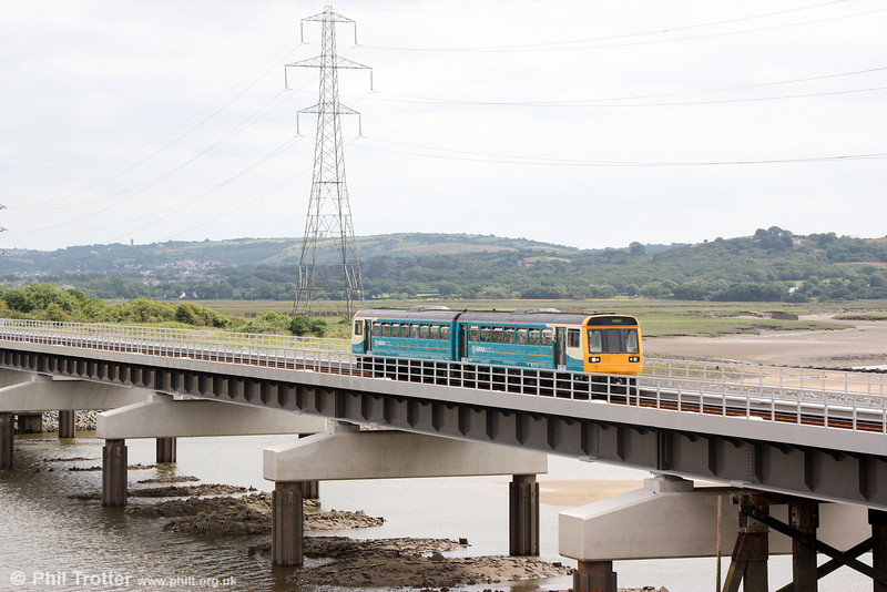 With all the contractor's equipment and scaffolding now removed, the new Loughor Viaduct can now be seen as the designers intended. 142073 crosses forming 2E24, 1335 Swansea to Pembroke Dock on 20th July 2013.