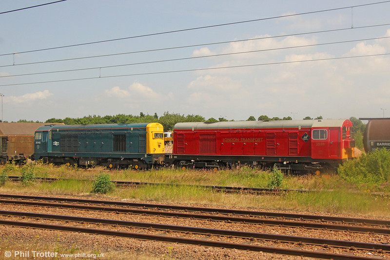 BR blue 20142 and London Transport red 20189 stabled at Peterborough on 13th July 2013.