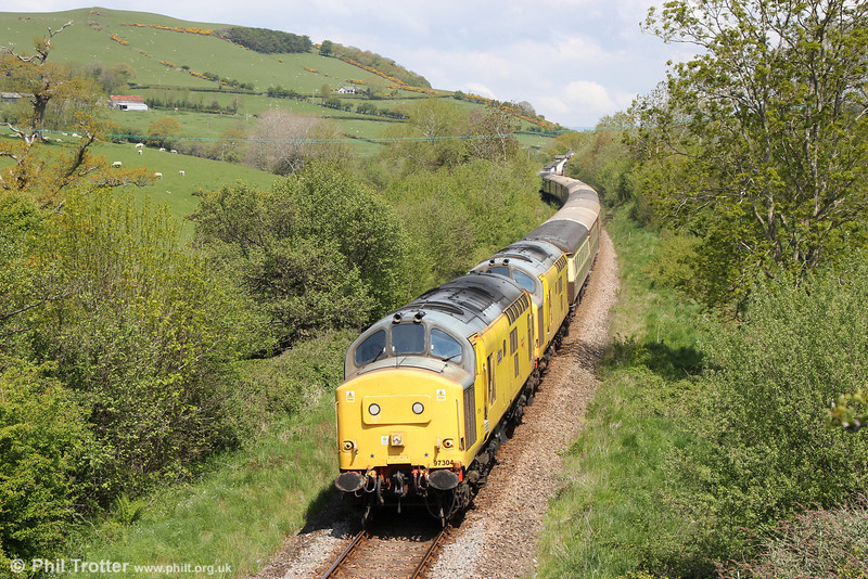 Network Rail 97304 'John Tiley' and 97303 at Llandre with Statesman Rail's 1Z96, 0526 Hull to Aberystwyth, 'The Welsh Mountain Statesman' on 25th May 2013. A bank holiday weekend with sunshine? Unheard of.