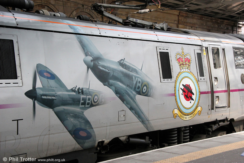 Spitfire and Hurricane graphics on Battle of Britain liveried 91110 'Battle of Britain Memorial Flight' at Edinburgh Waverley on 12th July 2013.