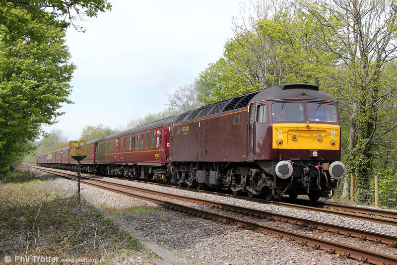 WCRC 47826 passes Glanlliw with Compass Tours 1Z52, 0605 Holyhead to Cardiff Central, 'The Heart of Wales Scenic Rambler' on 18th May 2013. Classmate 47854 'Diamond Jubilee' was at the rear.