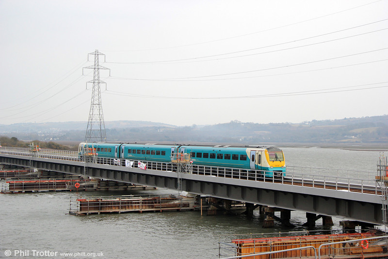 175116 crosses the new Loughor Viaduct on the first day of operation, 8th April 2013. The unit is forming 1V85, 1330 Manchester Piccadilly to Tenby.